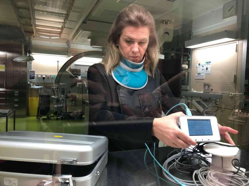Medical physicist at hospital wearing protective lead aprons